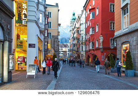 Innsbruck Austria - February 8 2010: People walking after the sunset in Friedrich Strasse