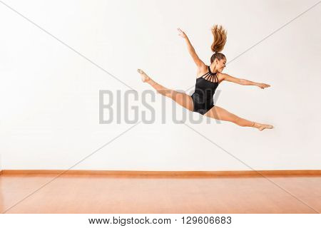 Happy Female Dancer Up In The Air
