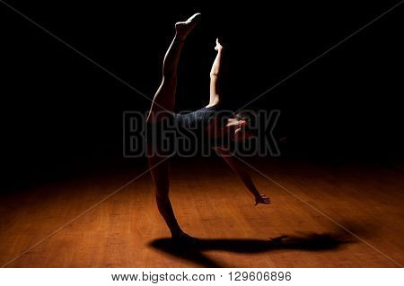 Young Dancer Doing Leg Split In A Stage