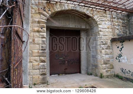 JOLIET, ILLINOIS / UNITED STATES - NOVEMBER 7, 2015: The back door of the old Illinois State Penitentiary in Joliet, Illinois.