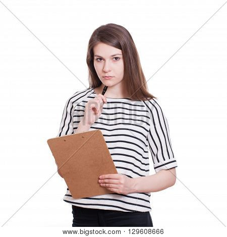 Young woman supervisor or inspector holding clipboard and pointing index finger to the camera isolated on white background