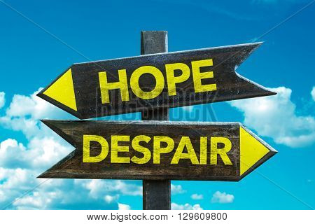 Hope - Despair crossroad with sky background
