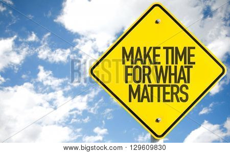 Make Time For What Matters sign with sky background