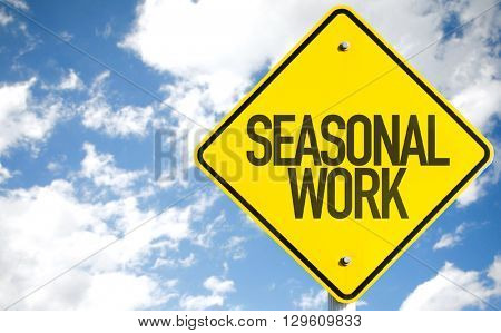 Seasonal Work sign with sky background