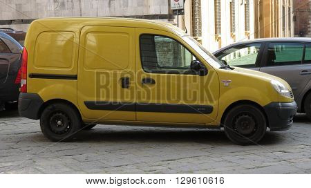 SIENA ITALY - CIRCA APRIL 2016: Yellow Renault dCi 70 van parked in a street of the city centre.