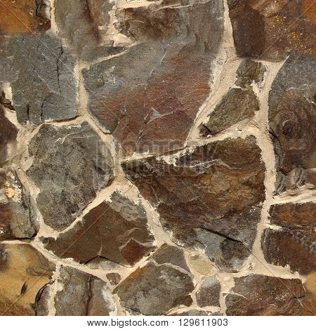 Seamless stone texture made of different stones. Seamless pattern for exterior design purposes