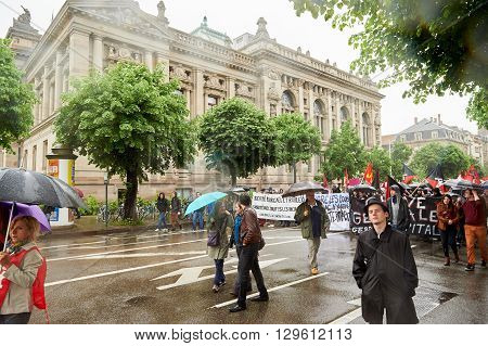 STRASBOURG FRANCE - MAY 12 2016: Closed boulevard under heavy rain as thousand of people demonstrate as part of nationwide day of protest against labor reforms by France Government