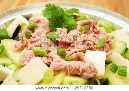 Close-Up of Flaked Tuna on a Green Vegetable Salad