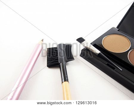 Set of eyebrows makeup brush pencil on white background