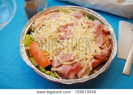 Appetizing Takeout Salad with Vegetables Meat and Cheese