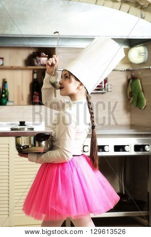 Little Girl With Pan And Ladle