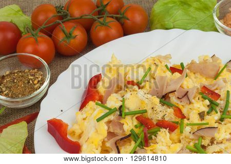Fresh scrambled eggs with bacon and vegetables. Domestic eggs for breakfast. Breakfast athletes. Preparing eggs. Protein diet. Eggs in different kinds of preparations.