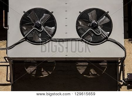 air conditioning fan,Outdoor Unit of Air Conditioner with pipes and shadow