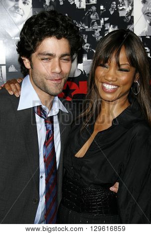 Garcelle Beauvais and Adrian Grenier at the season 3 premiere of HBO's 'Entourage' held at the Cinerama Dome in Hollywood, USA on April 5, 2007.