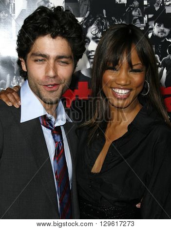 Adrian Grenier and Garcelle Beauvais at the season 3 premiere of HBO's 'Entourage' held at the Cinerama Dome in Hollywood, USA on April 5, 2007.