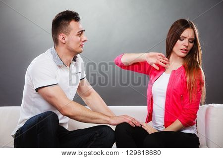 Couple Arguing Argue On Couch. Conflict At Home.