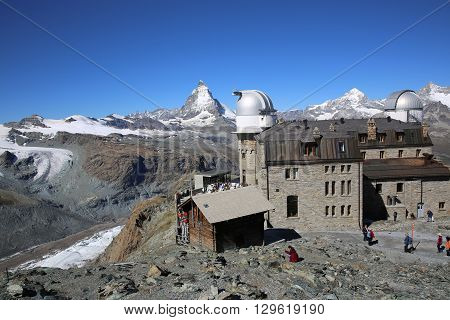 Zermatt, Switzerland - September 02, 2014: Gornergrat Station. On Top of the Hill the Gornergrat Railway stops on the Station - with a wonderful sight to Monte Rosa and Matterhorn Mountain.