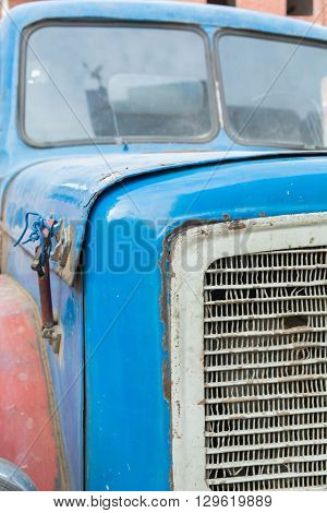 Vintage rusty red truck car with a old headlight, soft focus