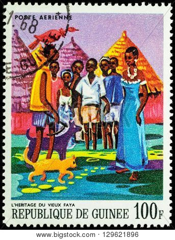 MOSCOW RUSSIA - MAY 12 2016: A stamp printed in Guinea shows image of African Legends - Heritage of the old Faya series