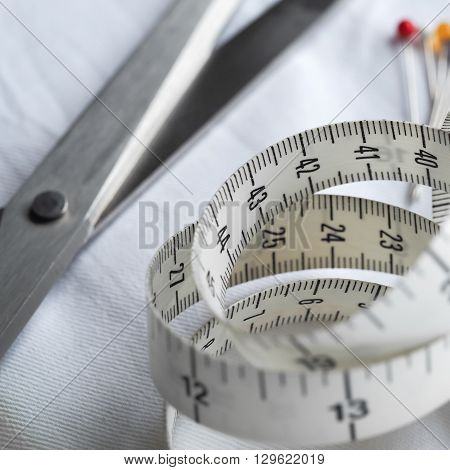 A tailor's or dress-maker's tape measure, in closeup.