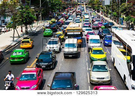 Bangkok, Thailand - March 13, 2016: Traffic Moves Slowly Along A Busy Road In Bangkok, Thailand