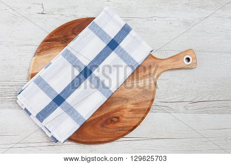 Checkered Kitchen Towel On Round Chopping Board