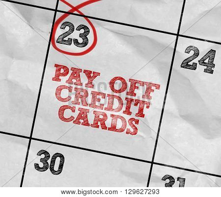 Concept image of a Calendar with the text: Pay Off Credit Cards
