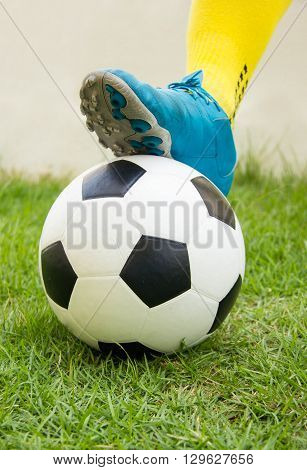 Football or soccer ball at the kickoff of a game.