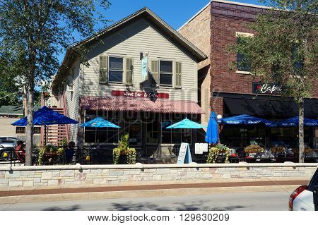 PLAINFIELD, ILLINOIS / UNITED STATES - SEPTEMBER 20, 2015: One may drink fine wine and enjoy artisan cheese at the Wine and Cheese by TCC Restaurant and Wine Bar in downtown Plainfield.