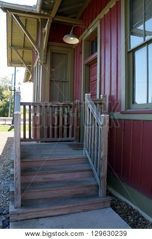PLAINFIELD, ILLINOIS / UNITED STATES - SEPTEMBER 20, 2015: A wooden stairway leads to the entrance to the old Plainfield Depot, which now serves as a museum operated by the Plainfield Historic Preservation Commission.