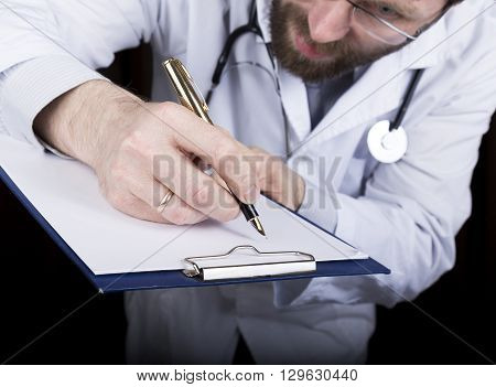 close-up hands of a medical doctor, the doctor signs a handle documents. Doctor writes medical history. write a prescription patient data history.