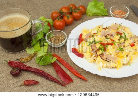 Homemade breakfast with a cup of coffee.Fresh scrambled eggs with bacon and vegetables. Breakfast athletes. Preparing eggs. Protein diet. Eggs in different kinds of preparations.