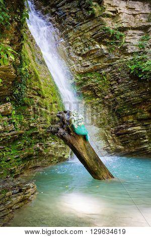 Mermaid at the waterfall on the tree in Russia, Krasnodar region