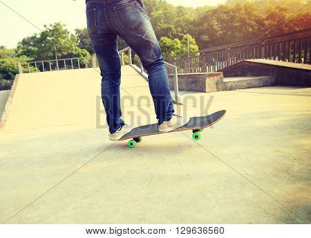young skateboarder skateboarding at outdoor skate park