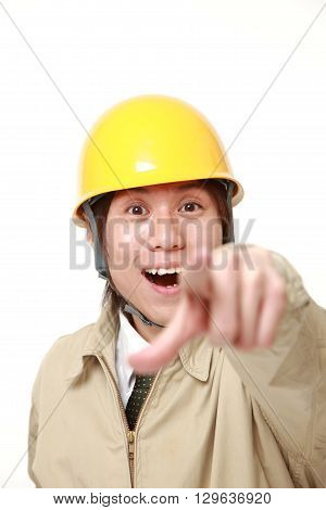 portrait of young Japanese construction worker discover something on white background