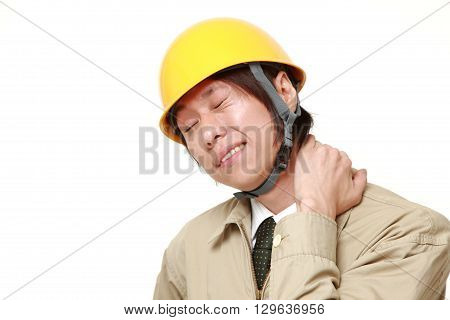 portrait of Japanese construction worker suffers from neck acheon white background