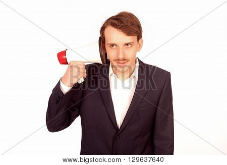 Business man listen to a megaphone at his ear