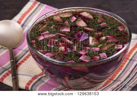 Cold beetroot soup on the table. Close up