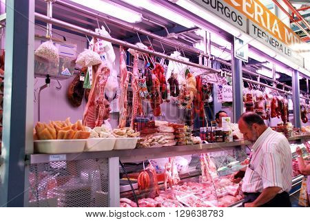 MALAGA, SPAIN - JULY 11, 2008 - Butcher stall in the indoor market (Mercado de Atarazanas) Malaga Malaga Province Andalucia Spain Western Europe, July 11, 2008.