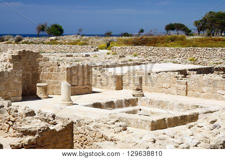 Temple ruins in archaeological park Tombs of the Kings ,Paphos,Cyprus, famous landmark, unesco heritage