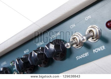 Image of guitar amplifier controllers isolated on white background