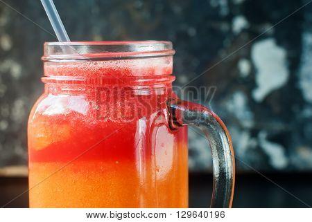 Fresh Juices Smoothie Glass Jar Water melon Papaya Red Orange Fruits Vitamins Healthy Concept on Dark Shabby Background