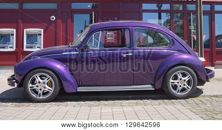 Phalsbourg, Alsace, France - May 5, 2016: Purple Volkswagen Beetle parked on the side of the street in the city of Phalsbourg.