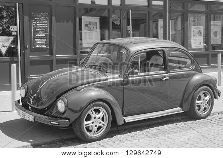Phalsbourg, Alsace, France - May 5, 2016: Volkswagen Beetle parked on the side of the street in the city of Phalsbourg.