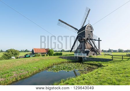 Back side of a polder mill in the Dutch village of Streefkerk which was built before the year 1751; now no longer in use as such but still capable to grind.