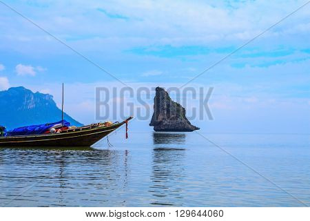 Spring trip to native boat Longtail. Morning mist on the Andaman Sea, Thailand