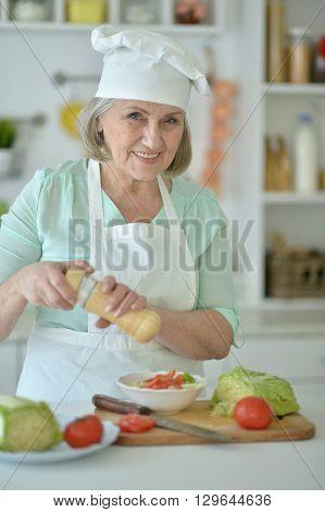Portrait of a senior woman chef portrait at kitchen