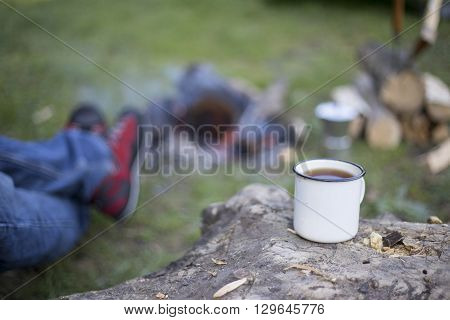 Man Drinking Coffee By The Fire.