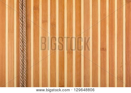 Two rope lying on a bamboo mat with a place for your text