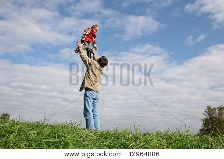 fly child on father's hands